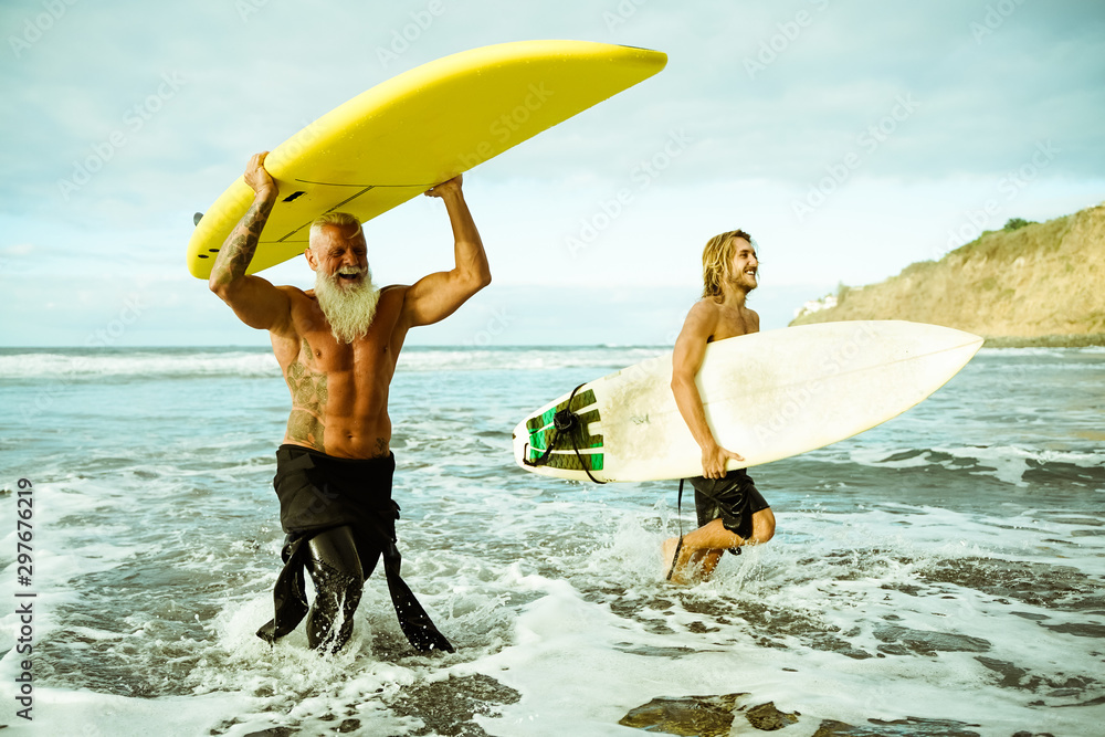Fototapety, obrazy: Best friends doing surfing in the summer time . People going out into the ocean. Sporty people lifestyle and extreme sport concept - Image