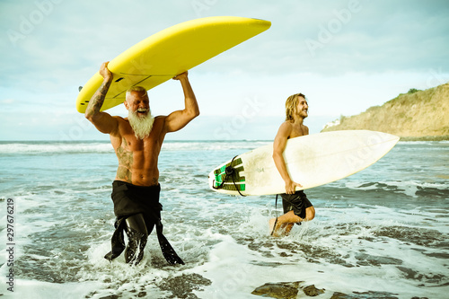 Best friends doing surfing in the summer time Wallpaper Mural
