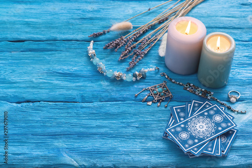 Fototapeta Blue tarot cards deck on blue wooden table background.