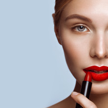 Beautiful Girl With Red Lips And Classic Makeup With Lipstick In Hand. Beauty Face