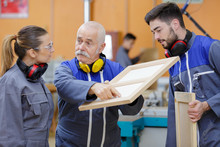 Teacher Pointing To Imperfection On Female Apprentices Creation