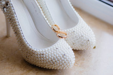 White Wedding Shoes And Pearls