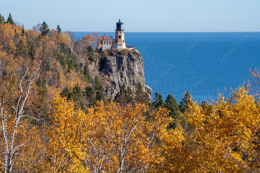 Fototapeta Autumn fall leaves with Split Rock Lighthouse in the distance on Lake Superior Minnesota