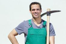 Male Farmer Posing Holding Hoe