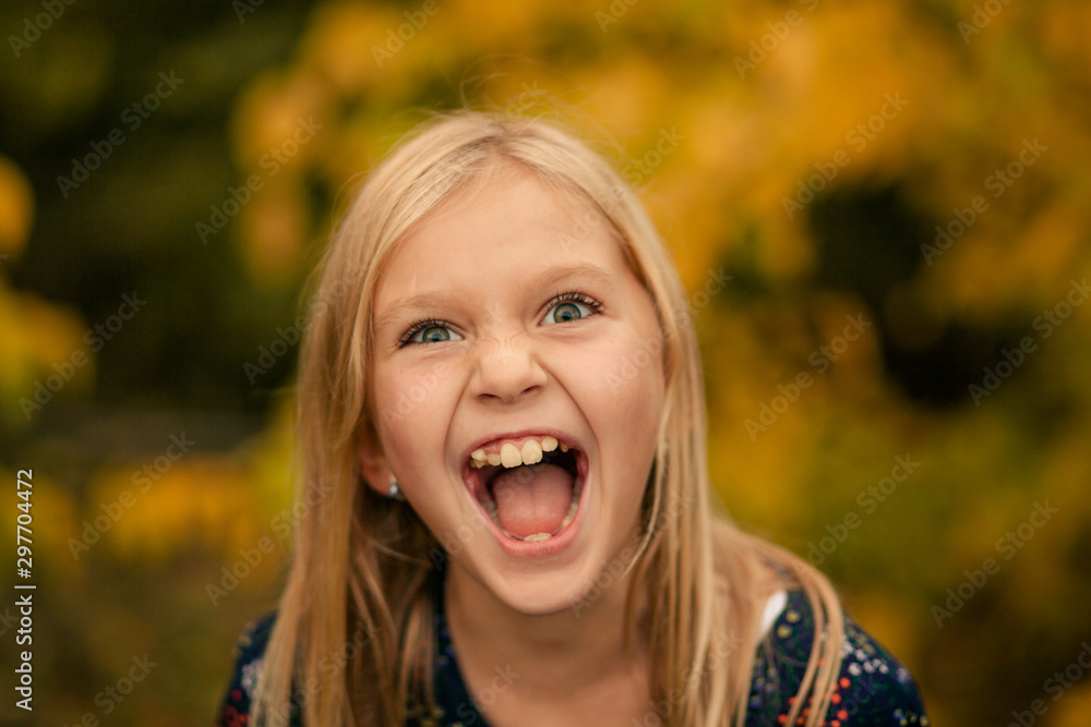 Fototapety, obrazy: portrait of a happy cute girl 8-9 years old