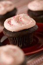 Chocolate Cupcakes With Pink Frosting And Sprinkles