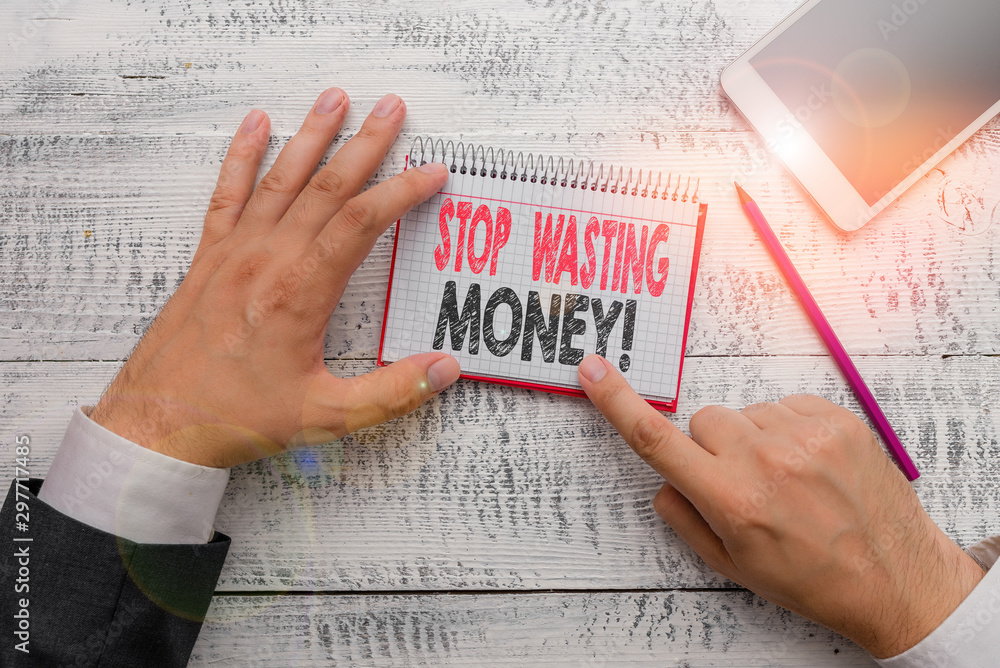 Fototapety, obrazy: Text sign showing Stop Wasting Money. Business photo text advicing demonstrating or group to start saving and use it wisely Hand hold note paper near writing equipment and modern smartphone device