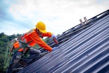 Roofer Worker In Protective Un...