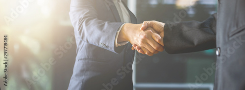 Fototapeta successful negotiate and handshake concept, two businessman shake hand with partner to celebration partnership and teamwork, business deal obraz