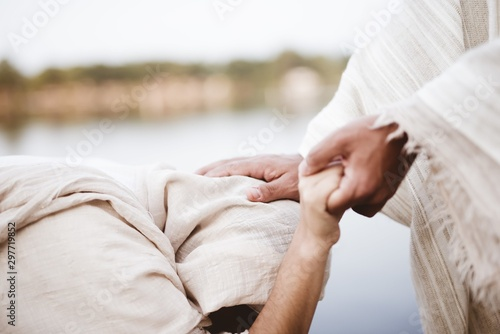 Closeup shot of Jesus Christ healing the female with a blurred background