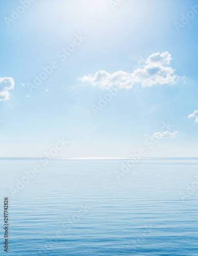 sunshine in blue sky with clouds over sea Canvas Print