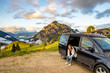 canvas print picture - Woman in front of motorhome on the Postalm in Austria