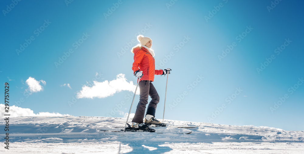 Fototapety, obrazy: Woman enjoying her winter vacation on ski