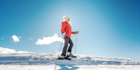 Woman enjoying her winter vacation on ski
