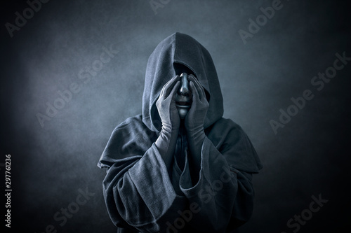 Fotografía  Ghostly figure in hooded cloak