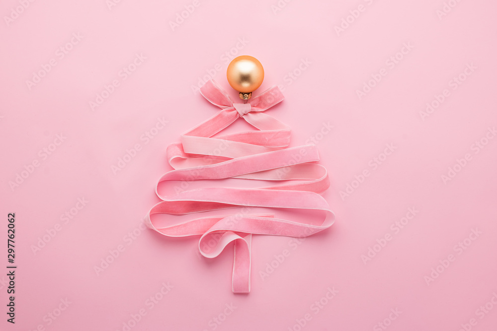 Fototapety, obrazy: Christmas creative tree made of ribbon decorated with golden ball a pastel pink background. Festive minimalism concept.