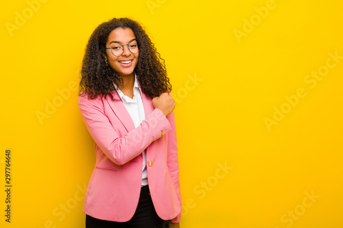 Cuadros en Lienzo black business woman feeling happy, positive and successful, motivated when faci