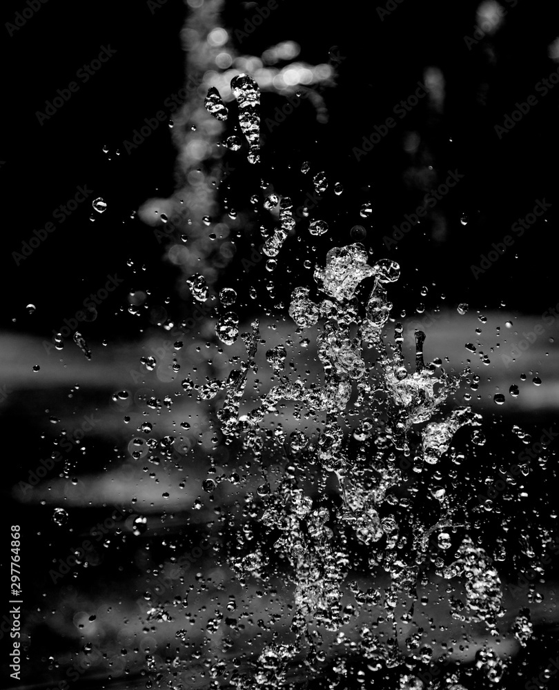 Fototapety, obrazy: drops of water with splashes on a black background