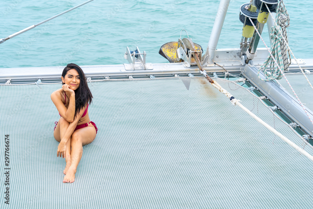 Fototapety, obrazy: portrait sexy asian girl in bikini sit down relaxing on  cruise yacht with background of blue water sea Concept luxury travel with nature of sea.