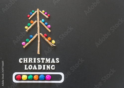 colorful christmas tree with loading bar on black background
