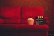 Leinwanddruck Bild - red sofa in cinema