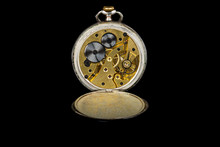 Old Antique Mechanical Golden Steel Pocket Watch With Open Lid Isolated On Black Background.