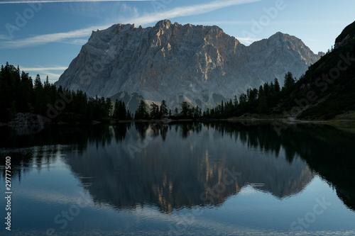 Foto auf Gartenposter Schwarz Seebensee reflection with mountain zugspitze, ehrwald leermoss austria alps