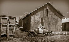 Old Jalopy In Front Of A Wooden Shed