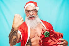 Happy Fit Santa Claus Holding ...
