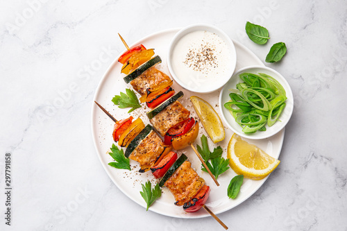 Fototapeta Grilled salmon and vegetables skewers on white plate obraz