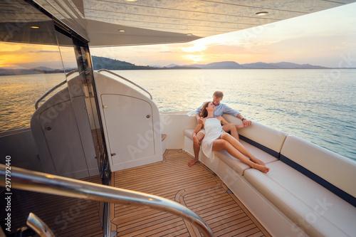 Fototapeta Loving couple on the yacht. obraz