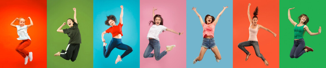 FototapetaYoung emotional people on multicolored backgrounds. Young surprised women jumping happy. Human emotions, facial expression concept, modern technologies. Trendy colors in collage.