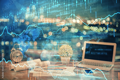 Fotografía  Double exposure of chart and financial info and work space with computer background