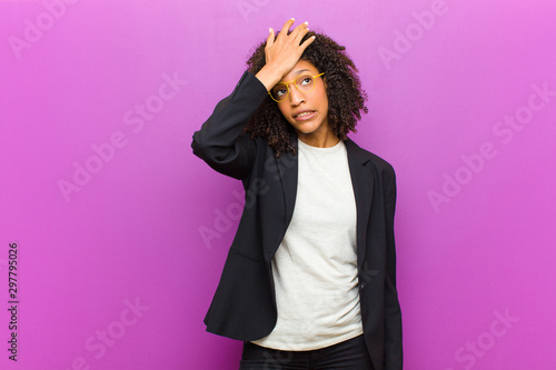 Fotografie, Obraz  young black business woman raising palm to forehead thinking oops, after making