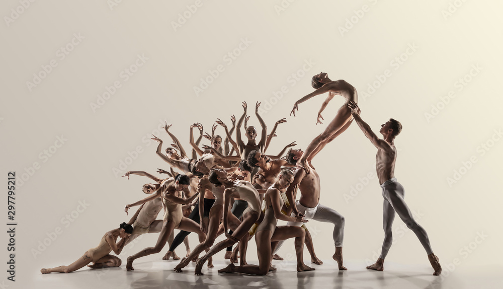 Fototapeta Support. Group of modern ballet dancers. Contemporary art. Young flexible athletic men and women in tights. Negative space. Concept of dance grace, inspiration, creativity. Made of shots of 11 models.