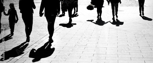 Silhouettes of a crowd of people in backlight Canvas Print