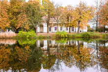 Autumn Landscape With Colorful Trees And Reflection In Water In The Royal Baths Park In Warsaw Poland.