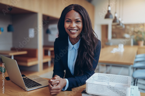 Smiling young African American businesswoman working in an offic - 297800292