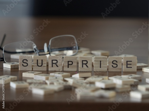 The concept of Surprise represented by wooden letter tiles Wallpaper Mural