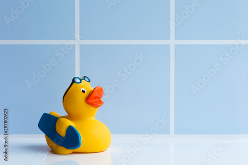 Leinwand Poster Yellow rubber duck with surfboard