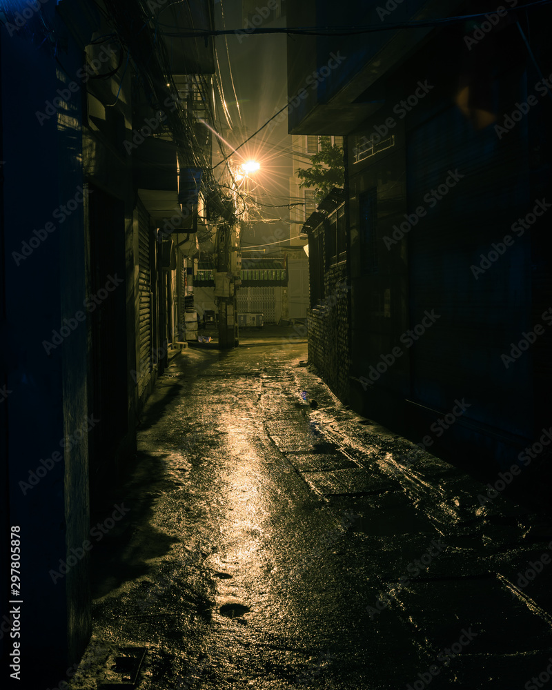 Fototapety, obrazy: Filtered image empty and dangerous looking urban back-alley at night time in suburbs Hanoi