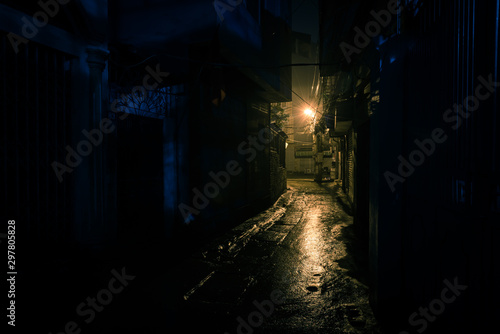 Fototapeta Empty and dangerous looking urban back-alley at night time in suburbs Hanoi obraz