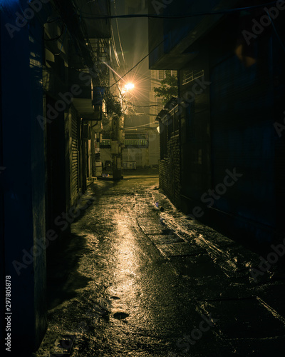 Poster Ruelle etroite Filtered image empty and dangerous looking urban back-alley at night time in suburbs Hanoi
