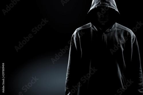Obraz Thief in black clothes on grey background - fototapety do salonu