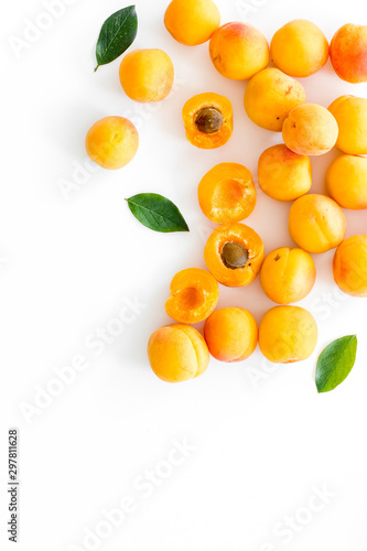 Fruit background with apricots and leaves on white background top view space for Wallpaper Mural