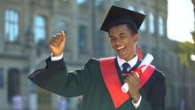 Cheerful Male Dancing Celebrating Graduation Outdoors University, Knowledge