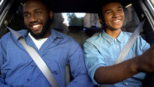 Happy Afro-american Father And Teen Sitting In Car, Dad Pleased With Sons Drive