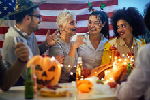 People In Costume Celebrate Together A Halloween Party