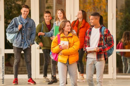 Stampa su Tela  Group of teenage students near university