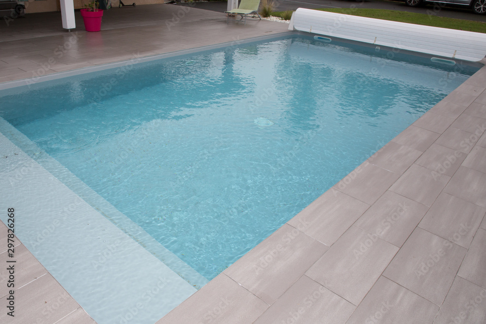 Fototapety, obrazy: swiming-pool in garden home with rigid pool cover rolled up on roller